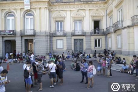 People play Pokemon Go in an urban park in Rio de Janeiro